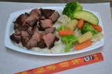 <p>Teriyaki Beef is hands down the most tender and flavorful beef in the universe. Shown with rice and vegetables</p>